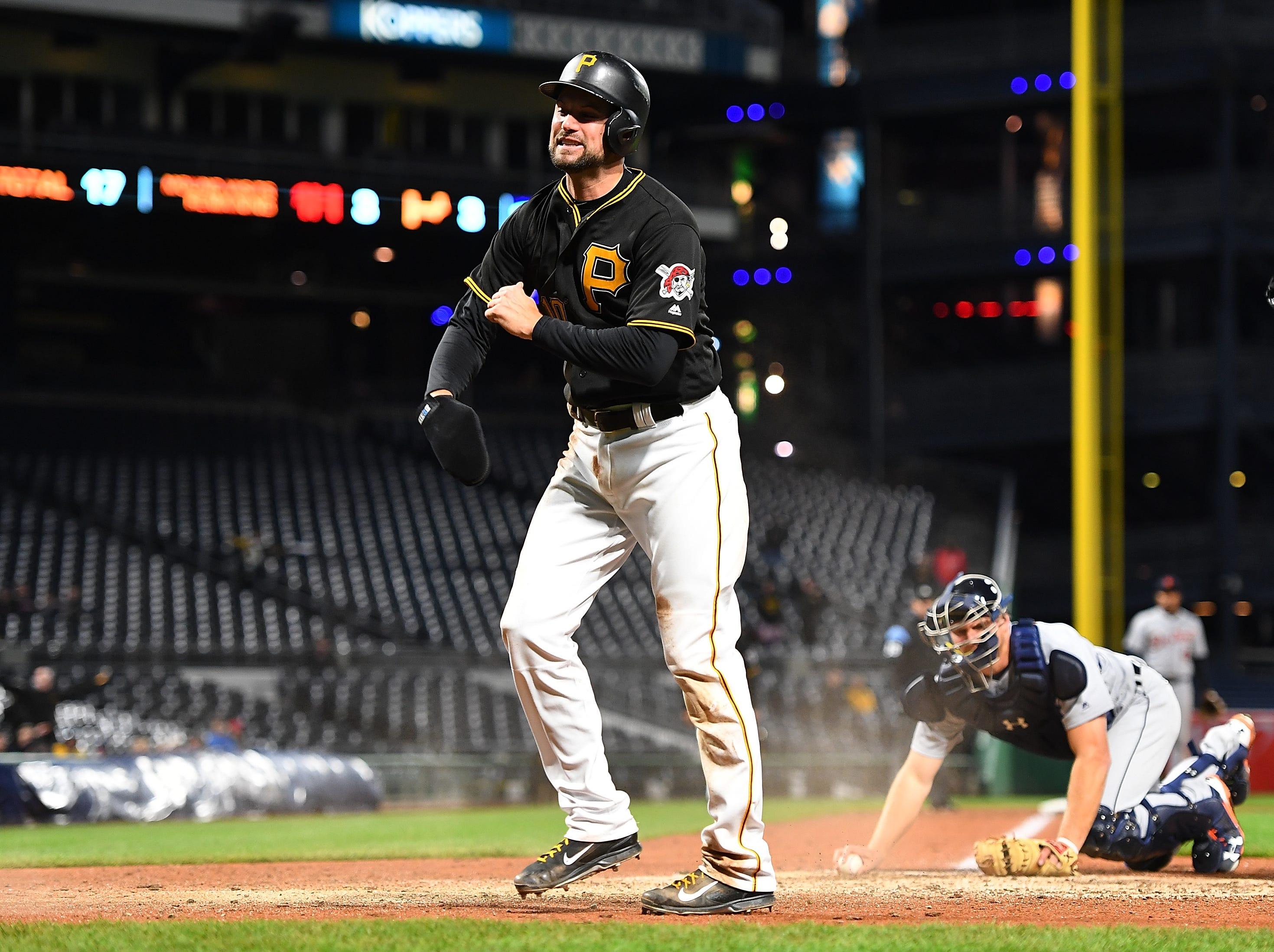 Jordy Mercer of the Pittsburgh Pirates reacts after scoring in the eighth inning against the Detroit Tigers in the eighth inning during Game 2 of a doubleheader at PNC Park on April 25, 2018 in Pittsburgh, Pennsylvania.