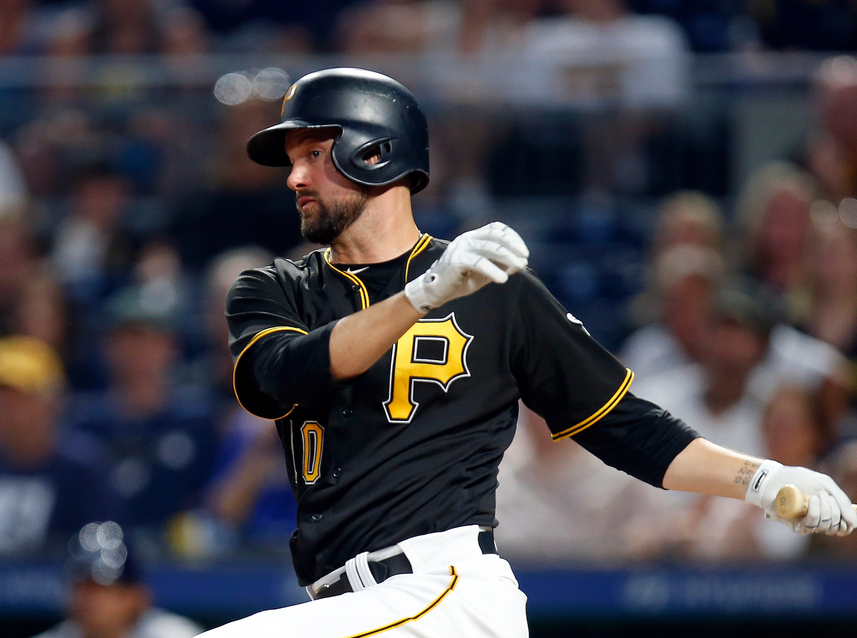 Jordy Mercer of the Pittsburgh Pirates hits a RBI double in the seventh inning against the Milwaukee Brewers at PNC Park on June 18, 2018 in Pittsburgh, Pennsylvania.