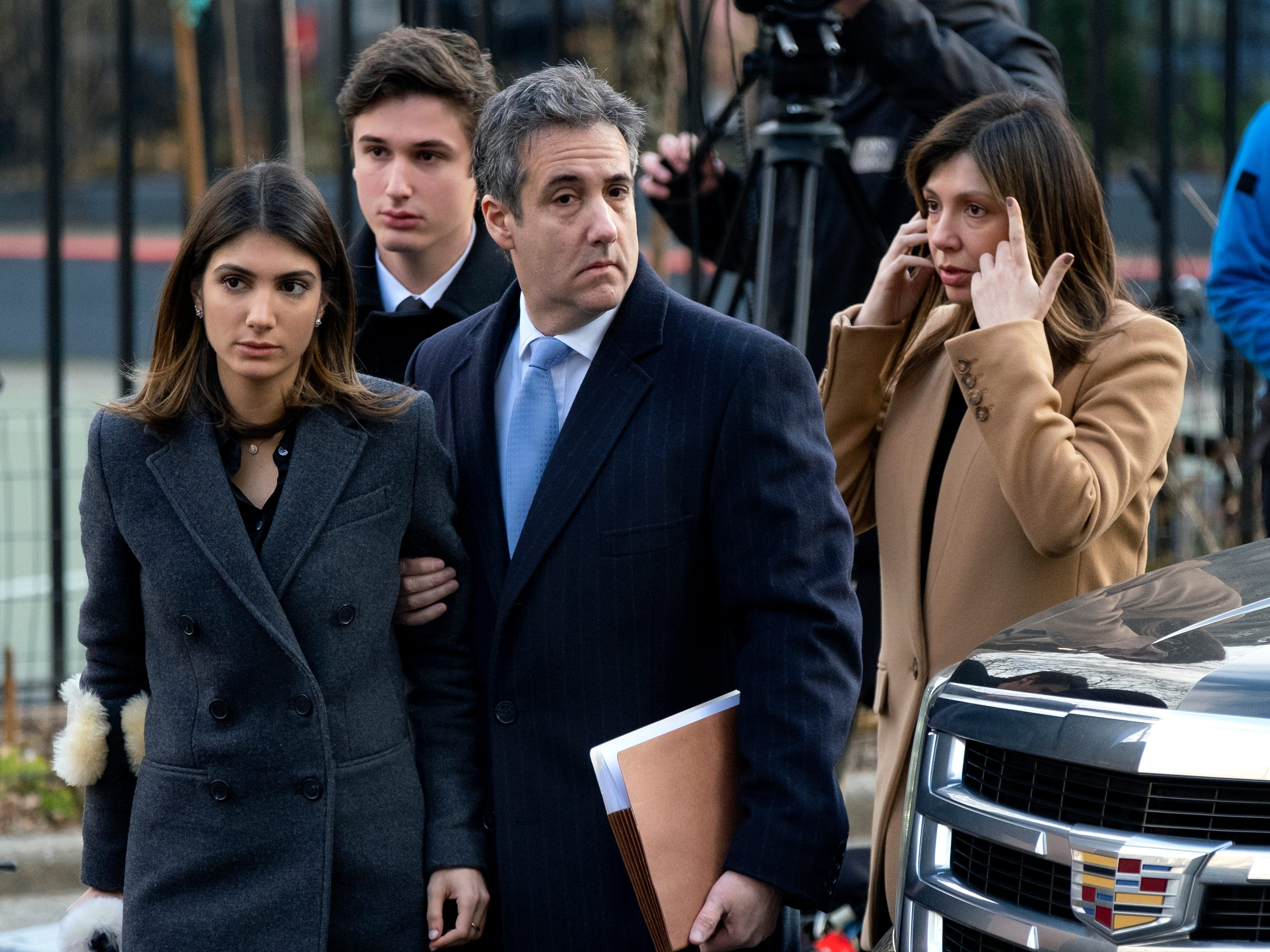 Michael Cohen, President Donald Trump's former lawyer, accompanied by his children, Samantha and Jake, and his wife, Laura Shusterman, arrives at federal court for his sentencing for dodging taxes, lying to Congress and violating campaign finance laws Wednesday, Dec. 12, 2018, in New York.