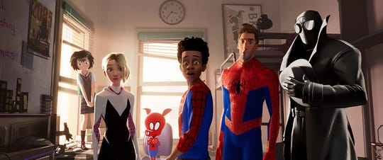 "Miles Morales (center) and the various other Spider-Men characters in ""Spider-Man: Into the Spider-Verse."""