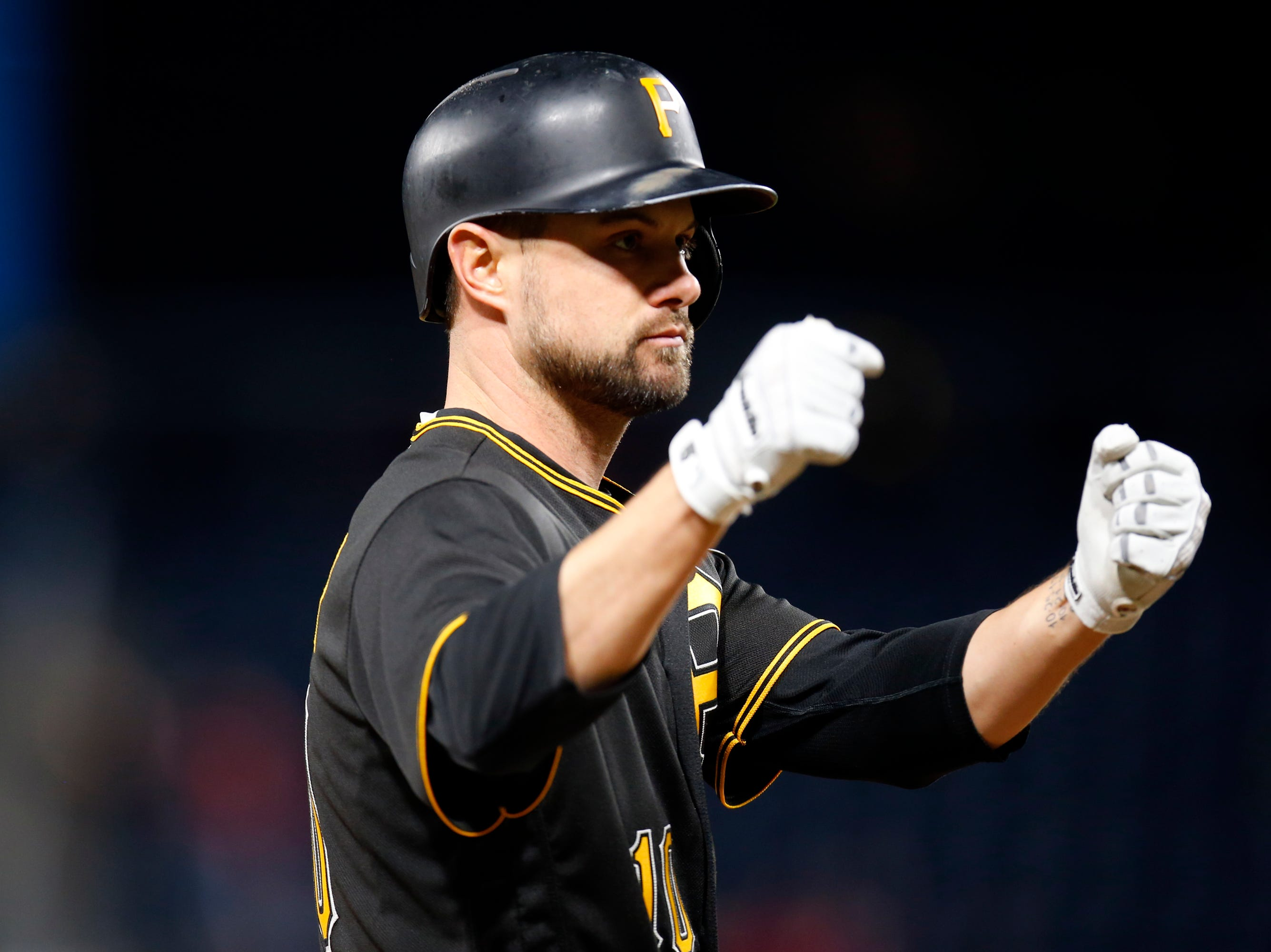 Jordy Mercer of the Pittsburgh Pirates reacts after hitting a two-RBI double in the ninth inning against the St. Louis Cardinals at PNC Park on April 27, 2018 in Pittsburgh, Pennsylvania.