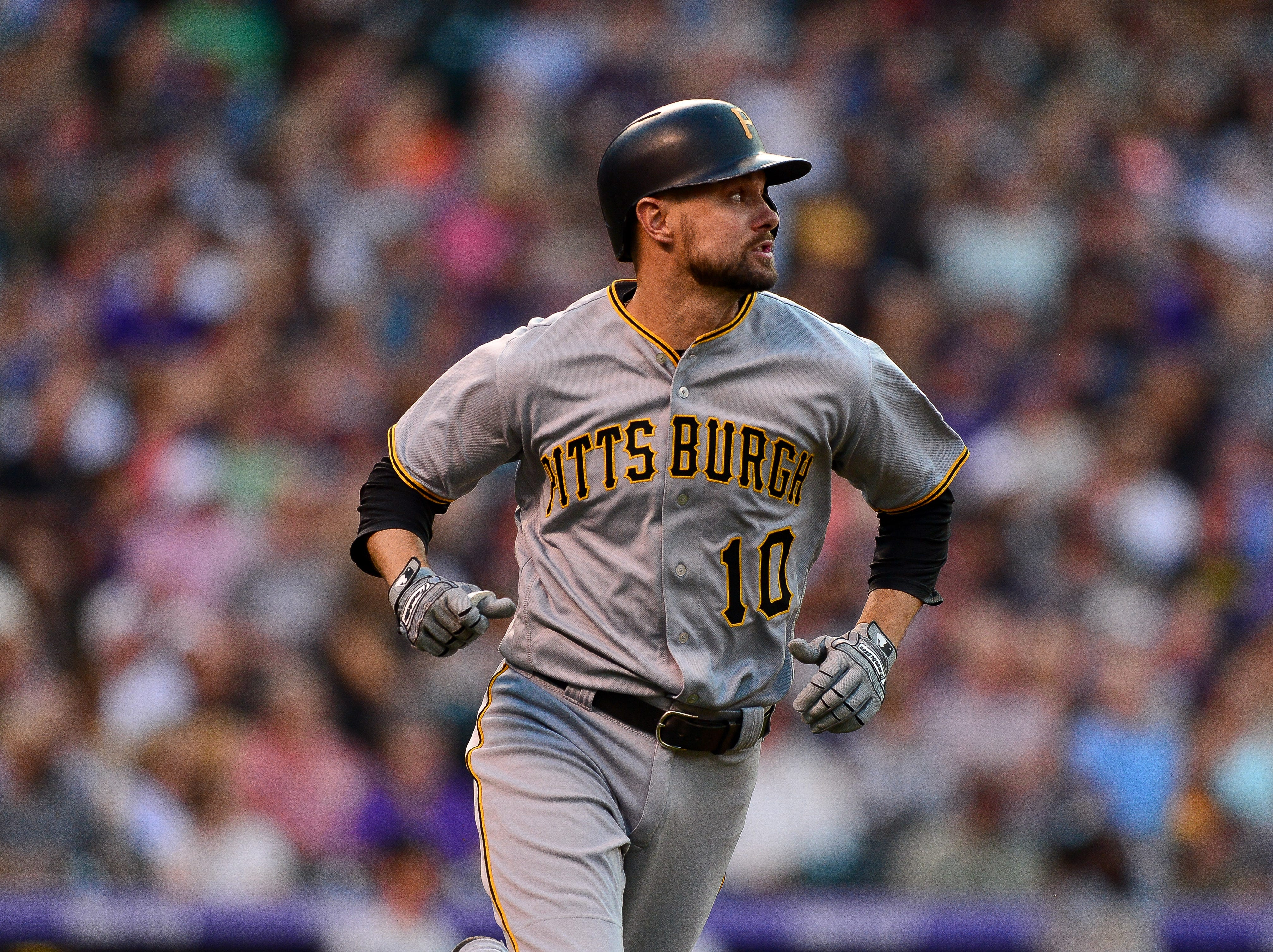 Jordy Mercer of the Pittsburgh Pirates watches the flight of a fourth inning three run home run hit off of Chad Bettis of the Colorado Rockies during a game at Coors Field on August 7, 2018 in Denver, Colorado.