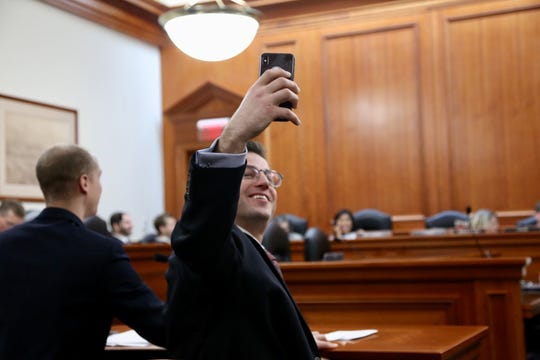 "Joel Crookston of Portage takes a selfie during a Dec. 12, 2018 Michigan House Elections Committee meeting. Crookston is the plaintiff in a federal lawsuit challenging Michigan's ban on ""ballot selfies."""