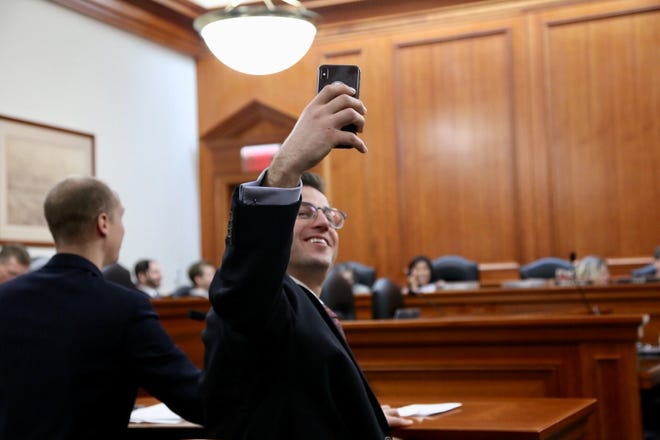 Joel Crookston of Portage takes a selfie during the House Elections Committee meeting on Dec. 12, 2018.