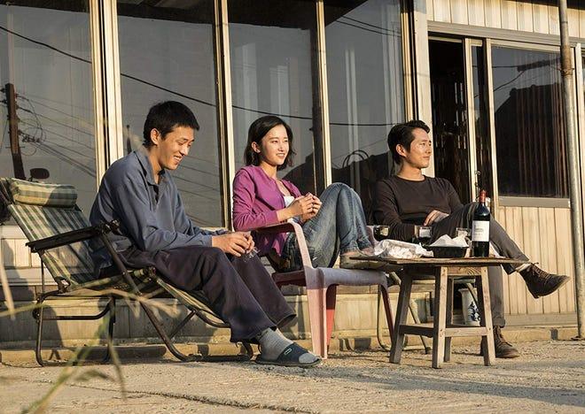 "Ah-in Yoo, Jong-seo Jun and Steven Yeun in 'Burning."""
