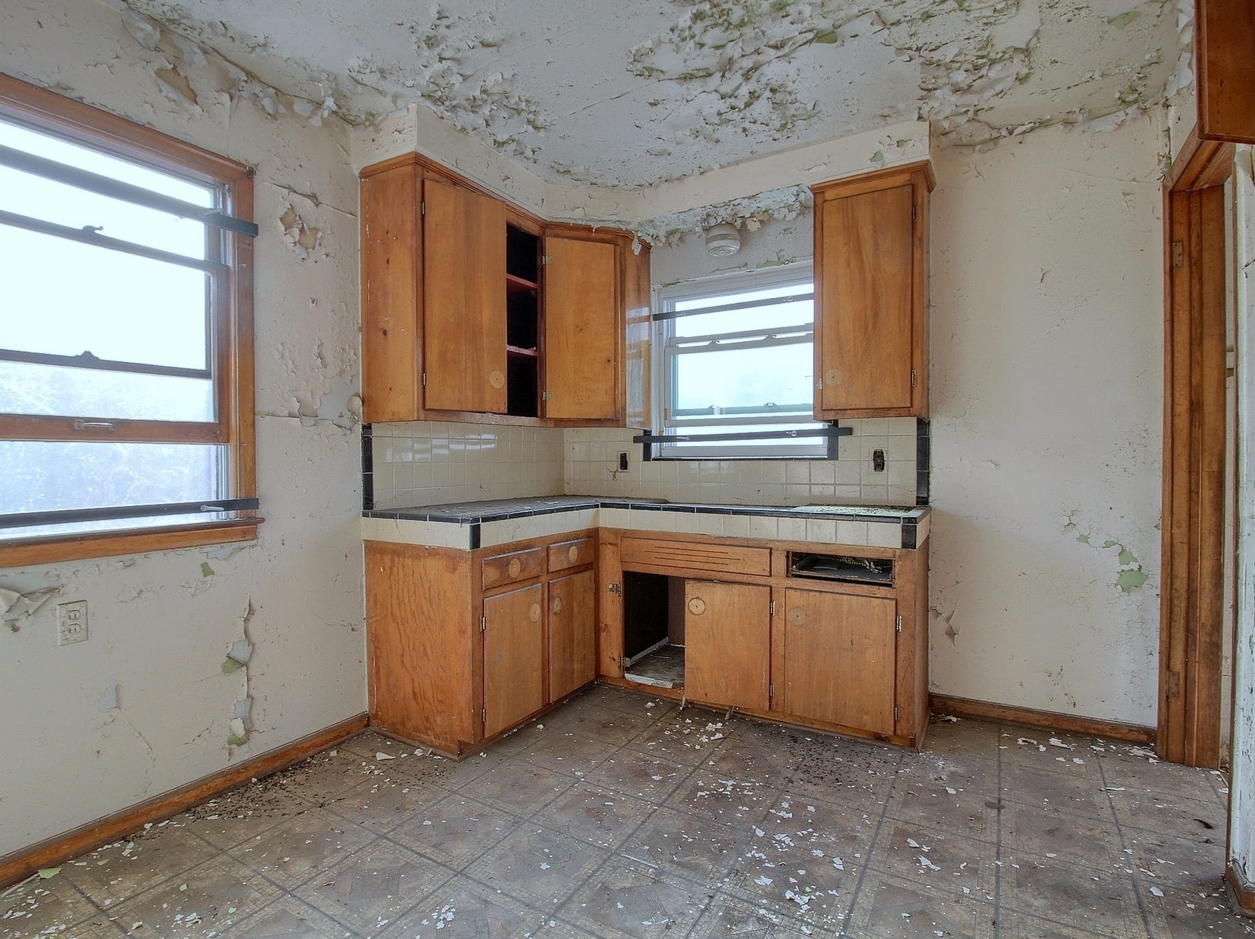 Before: This is the kitchen of Maria Walkenback's new home in Detroit's Warrendale neighborhood before the 983-square-foot house was renovated.