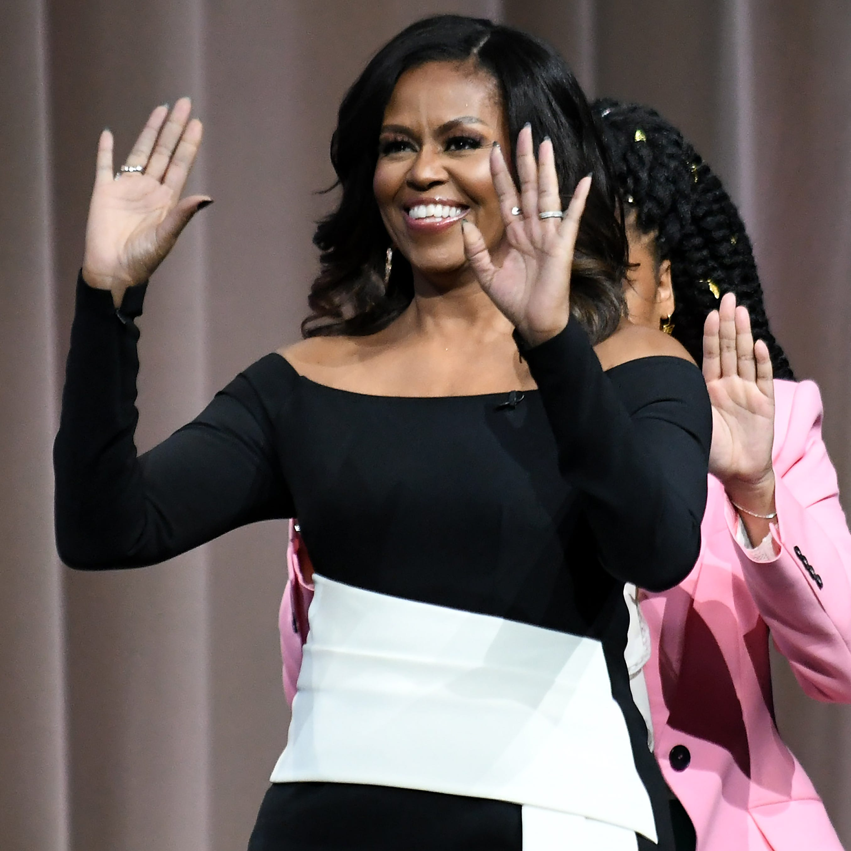 Michelle Obama tells crowd: 'Be brave enough to open ourselves up'