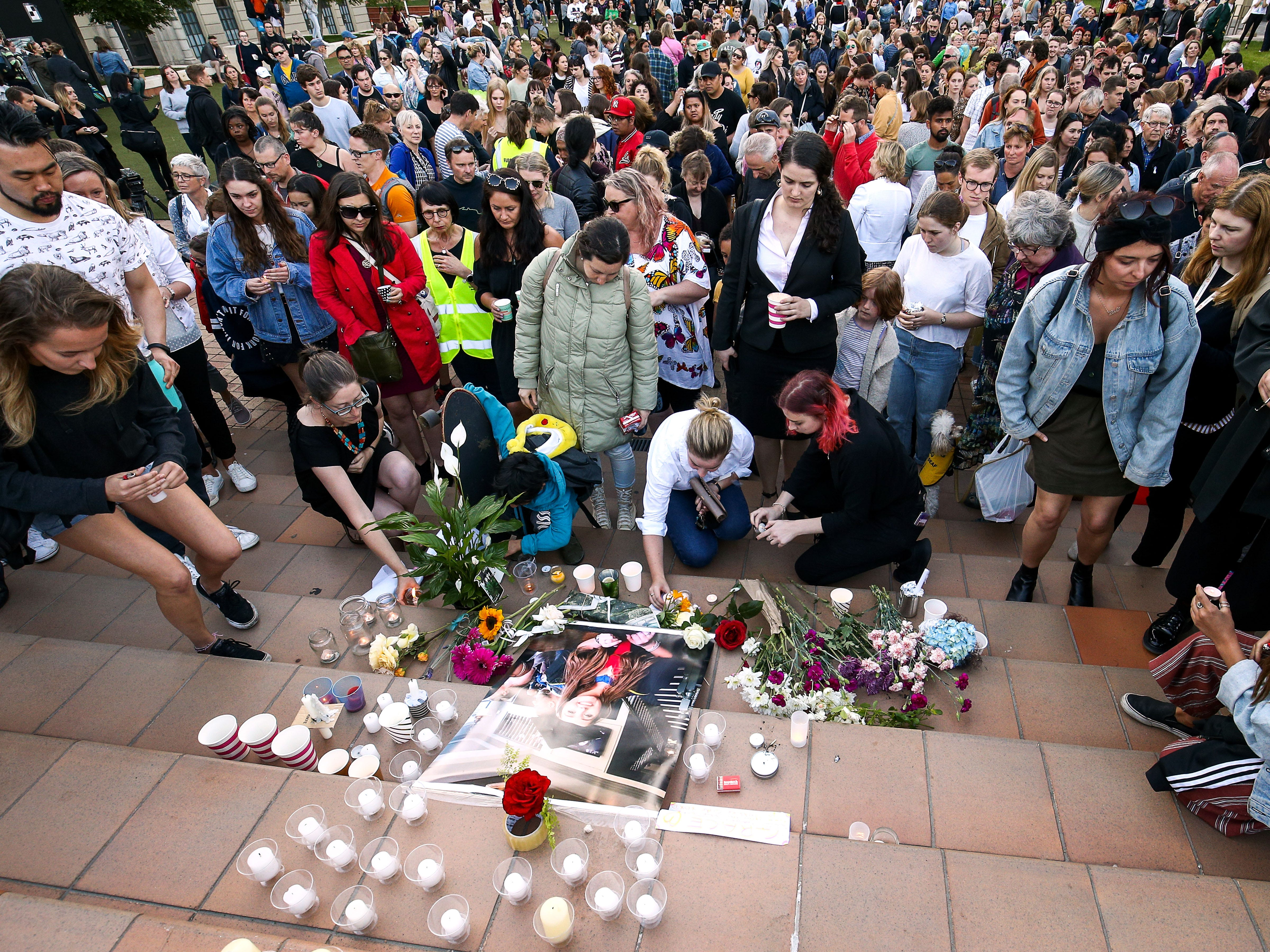Members of the public pay their respects during a vigil for backpacker Grace Millane at Civic Square on Dec. 12, 2018 in Wellington, New Zealand. The body of the 22-year-old was found in a section of bush near West Auckland's Waitakere Ranges on Sunday, following an extensive search for the British tourist. She was seen on Saturday, Dec. 1 at the CityLIfe hotel in Auckland. A 26-year-old man appeared in Auckland District Court on Monday charged with her murder. The judge granted a suppression order prohibiting the publication of the accused's name.