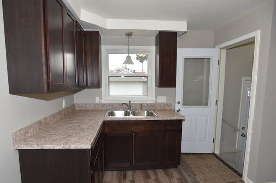 This is the newly renovated kitchen. Homeowner Maria Walkenbach says she has saved her money and will buy new appliances.