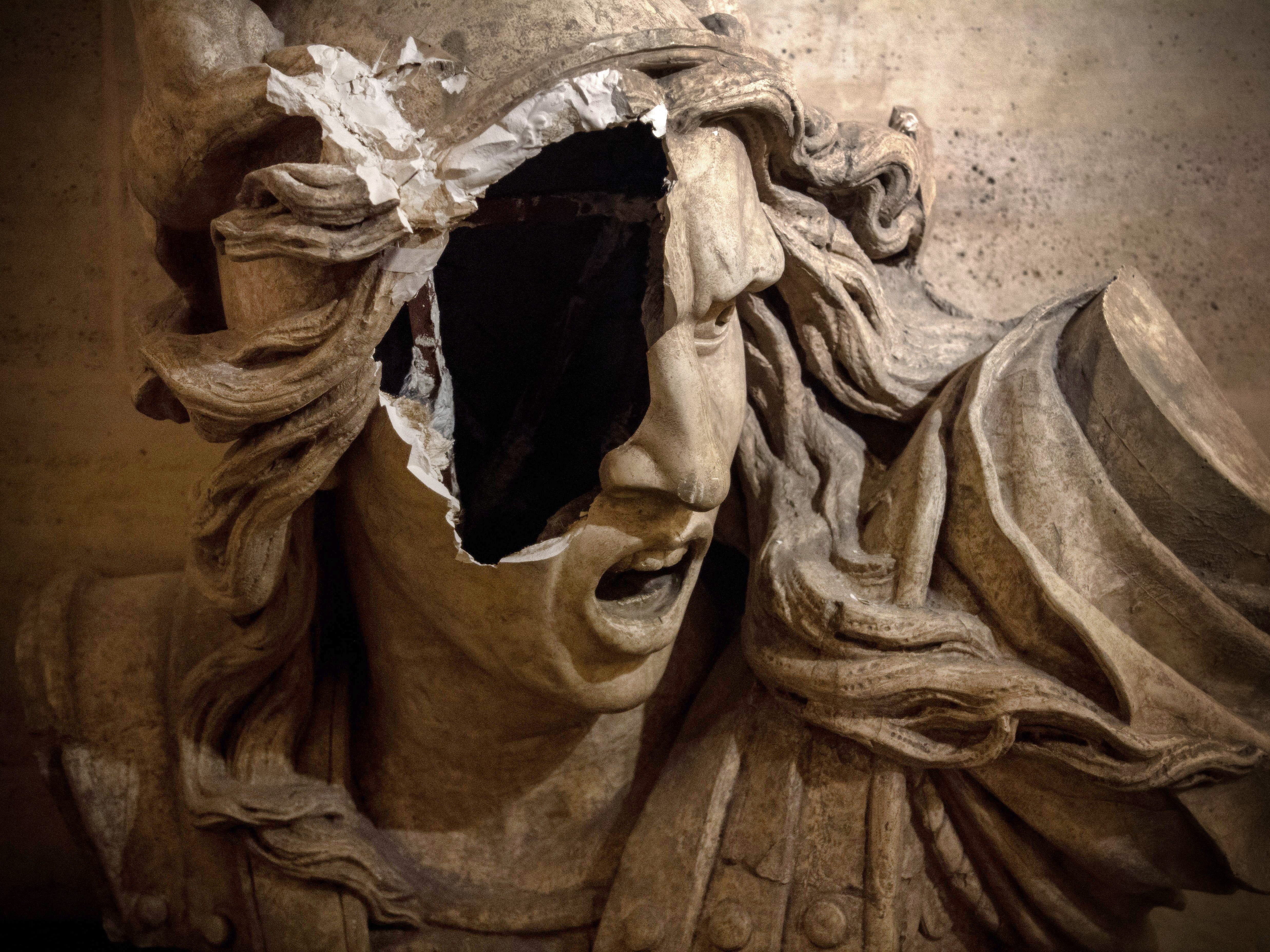 """A statue damaged in the Dec. 1 """"Yellow Vests"""" anti-government protests is seen in a gallery of the Arc de Triomphe on the day of its reopening in Paris, France, on Dec. 12, 2018."""
