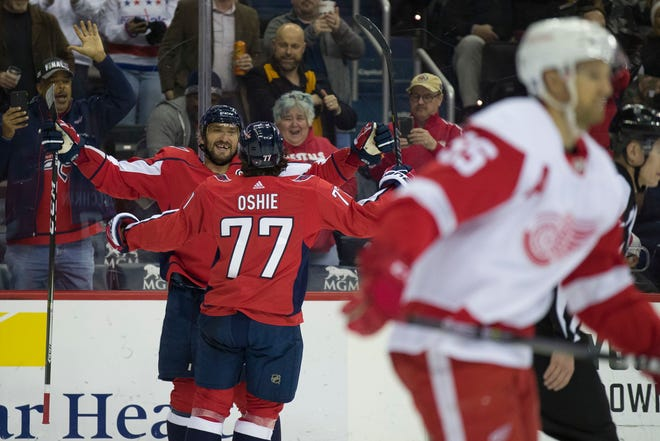 Washington Capitals left wing Alex Ovechkin and right wing T.J. Oshie  celebrate Ovechkin's goal in the second period.