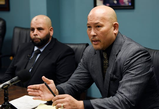Lawyer Wolfgang Mueller, (r), with his client Mubarez Ahmed (left), 49, of Dearborn, talks about their 105 million dollar lawsuit against the city of Detroit for wrongful conviction