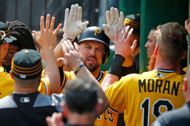 Jordy Mercer celebrates after hitting a home run in the sixth inning against the Padres during the game at PNC Park on May 20, 2018.