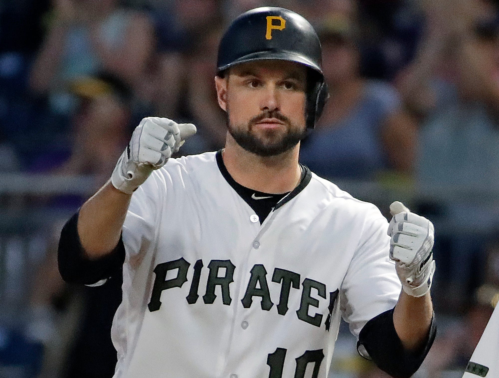 Pittsburgh Pirates' Jordy Mercer celebrates after driving in two runs with a single off Milwaukee Brewers relief pitcher Adrian Houser in the sixth inning of a game in Pittsburgh, Thursday, July 12, 2018.