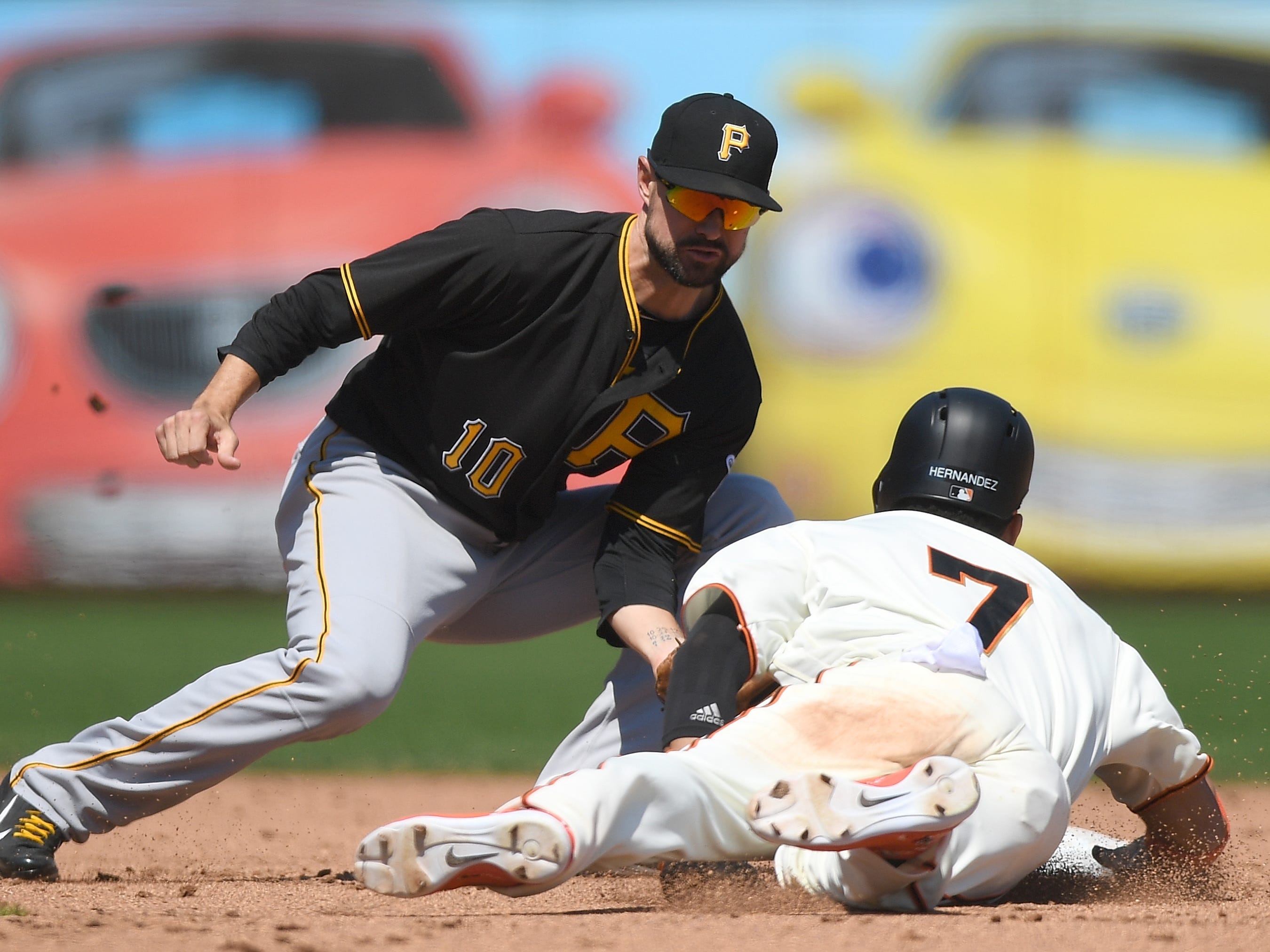 Gorkys Hernandez of the San Francisco Giants steals second base ahead of the throw to Jordy Mercer of the Pittsburgh Pirates in the bottom of the sixth inning at AT&T Park on August 12, 2018 in San Francisco, California.
