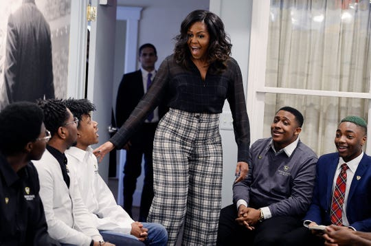 Michelle Obama makes a surprise entrance on a roundtable discussion with a group of men from Wayne State University in Detroit on Dec. 11, 2018.