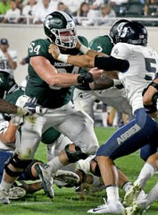 Michigan State offensive lineman Matt Allen (64) has missed three games because of injuries, but should be healthy for the Spartans' bowl game.