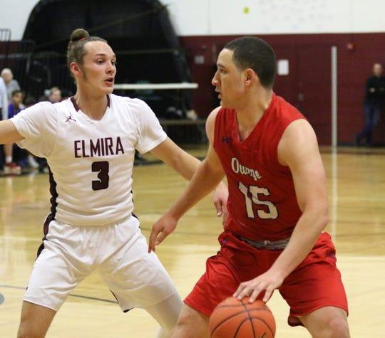 Owego's Kobe Bogart is defending by Luke Baldwin during a 60-38 loss to Elmira in boys basketball Dec. 11, 2018 at Elmira High School.
