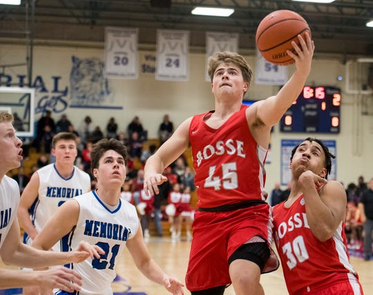 Bosse's Kolten Sanford (45), shooting a layup against Memorial on Dec. 11, returned from a broken foot injury Saturday at Terre Haute South. He was averaging 13.0 points before he was sidelined.