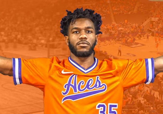 Evansville sophomore John Hall poses in the Purple Aces' throwback sleeved jerseys the team will wear Saturday at home against Jacksonville State.