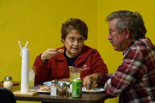 Laurie and Randy Hartman talk as they dine in at Stan's Una Pizza, located on Evansville's west side, Friday night, Dec. 7, 2018. The couple said they've been coming to the pizza place for about 15 years, calling in their order ahead of time so it's ready when they walk through the door and sit down at a table.