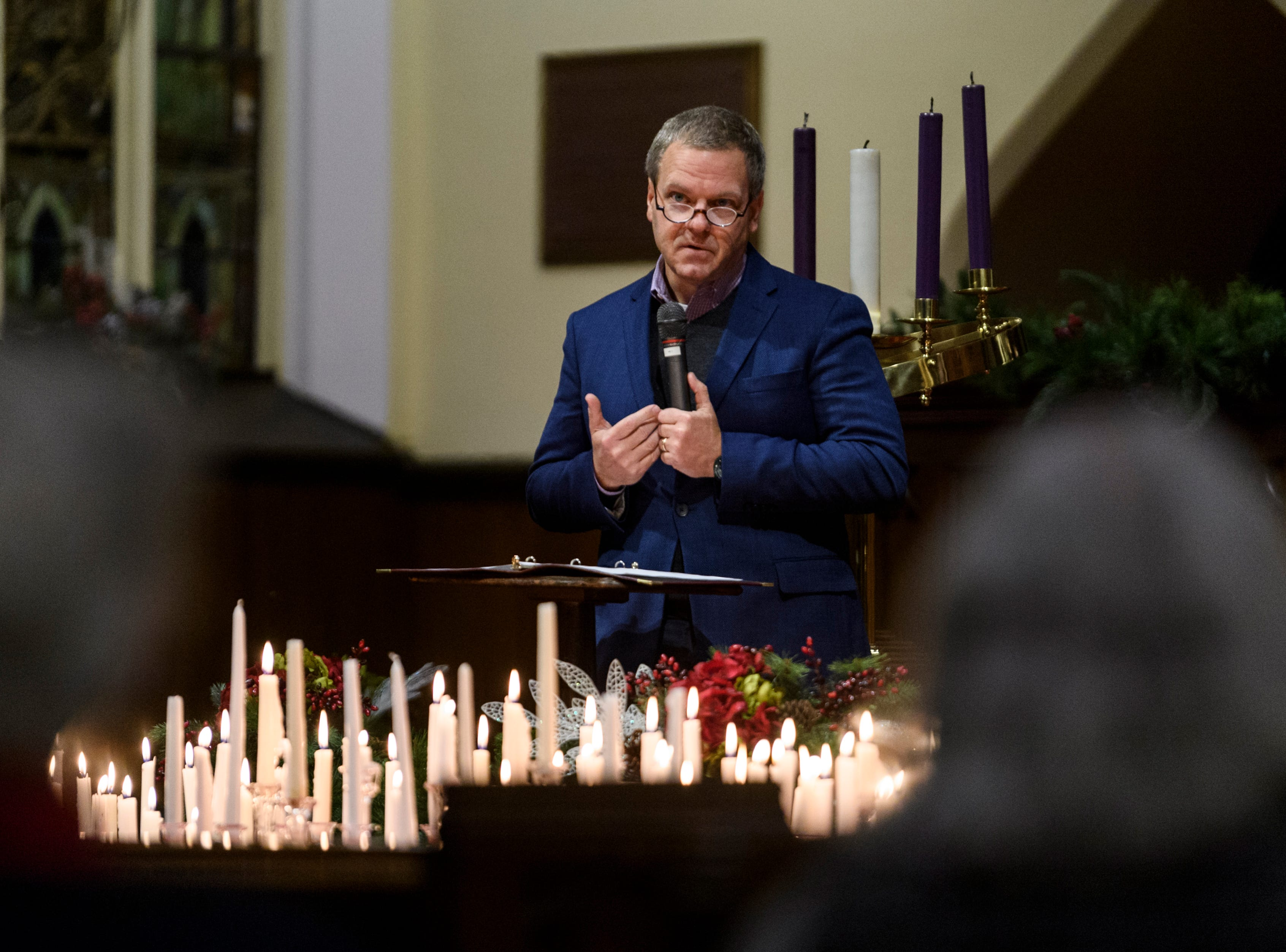 Rev. Scott Cassell of Turning Pointe United Methodist Church addresses the crowd with a spiritual message during the 18th annual Homeless Memorial service organized by Aurora, a local non-profit serving the homeless population, at Trinity United Methodist Church in Evansville, Ind., Tuesday, Dec. 11, 2018.