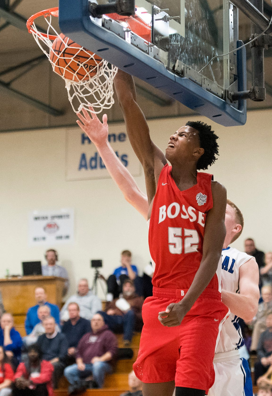 Bosse's Kiyron Powell (52) slams the ball in the basket during the varsity boys basketball game between the Memorial Tigers and Bosse Bulldogs at Memorial High School Tuesday, Dec. 11, 2018. Memorial won 57-45.