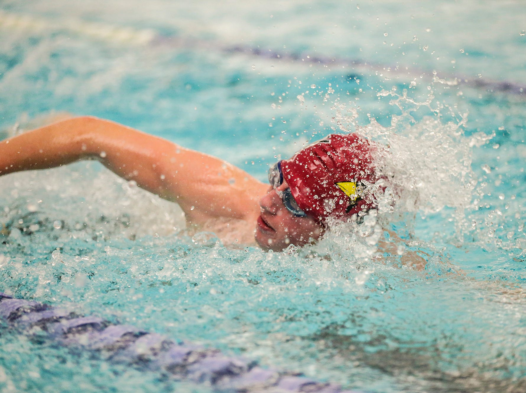 Fond du Lac High School's Charlie Quast competes in the 50 yard freestyle against Neenah High School during their swim meet Tuesday, December 11, 2018 in Fond du Lac, Wisconsin. Doug Raflik/USA TODAY NETWORK-Wisconsin
