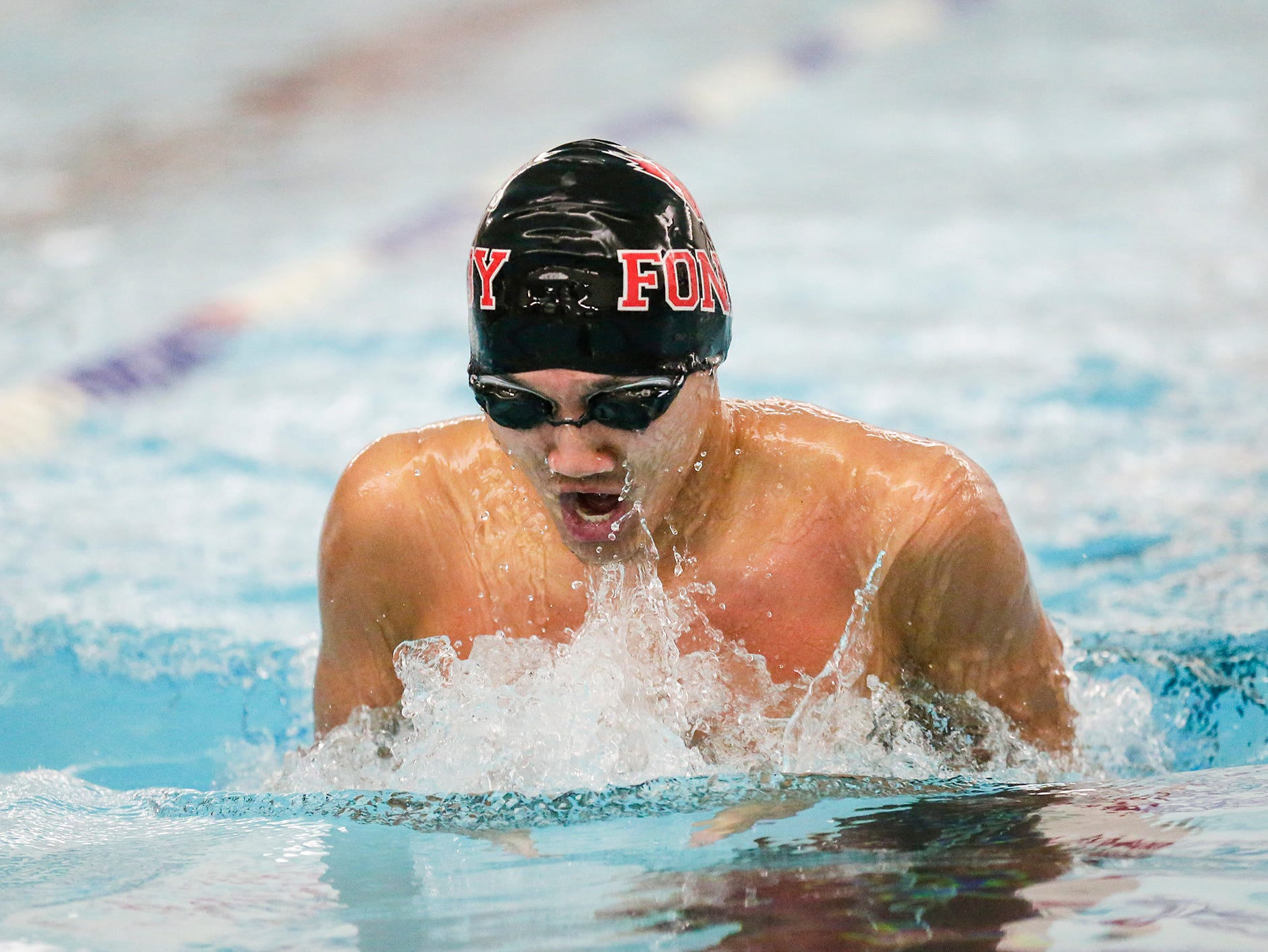Fond du Lac High School's Andrew Park competes in the 200 yard IM against Neenah High School during their swim meet Tuesday, December 11, 2018 in Fond du Lac, Wisconsin. Doug Raflik/USA TODAY NETWORK-Wisconsin