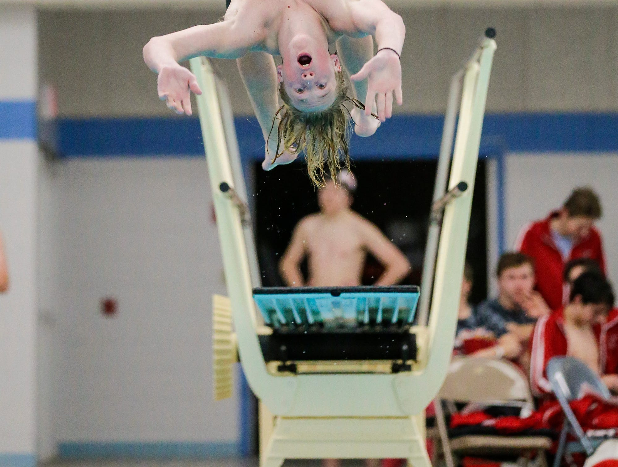 Fond du Lac High School's Charlie Quast competes in the diving competition against Neenah High School during their swim meet Tuesday, December 11, 2018 in Fond du Lac, Wisconsin. Doug Raflik/USA TODAY NETWORK-Wisconsin