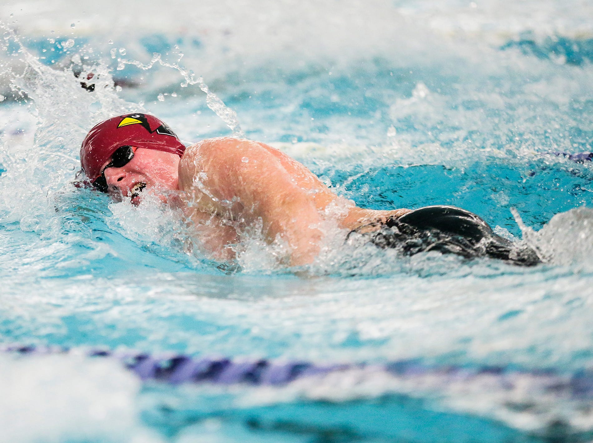 Fond du Lac High School's Bill Schultz competes in the 200 yard freestyle against Neenah High School during their swim meet Tuesday, December 11, 2018 in Fond du Lac, Wisconsin. Doug Raflik/USA TODAY NETWORK-Wisconsin