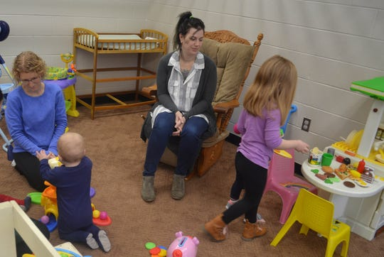 "Moms and kids play in the nursery during a ""Moms are BE YOU-tiful in Christ"" meeting."
