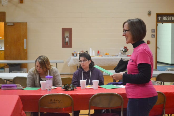 """Patti Greenhill leads a meeting of """"Moms are BE YOU-tiful in Christ."""" Greenhill was instrumental in starting the faith-based support group for moms."""