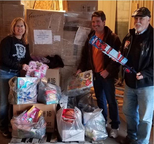Bikers Memorial Fund members Joanne Darr, Glenn Bliss and Cliff Spurrier donated toys to Sandusky County Toys for Tots.