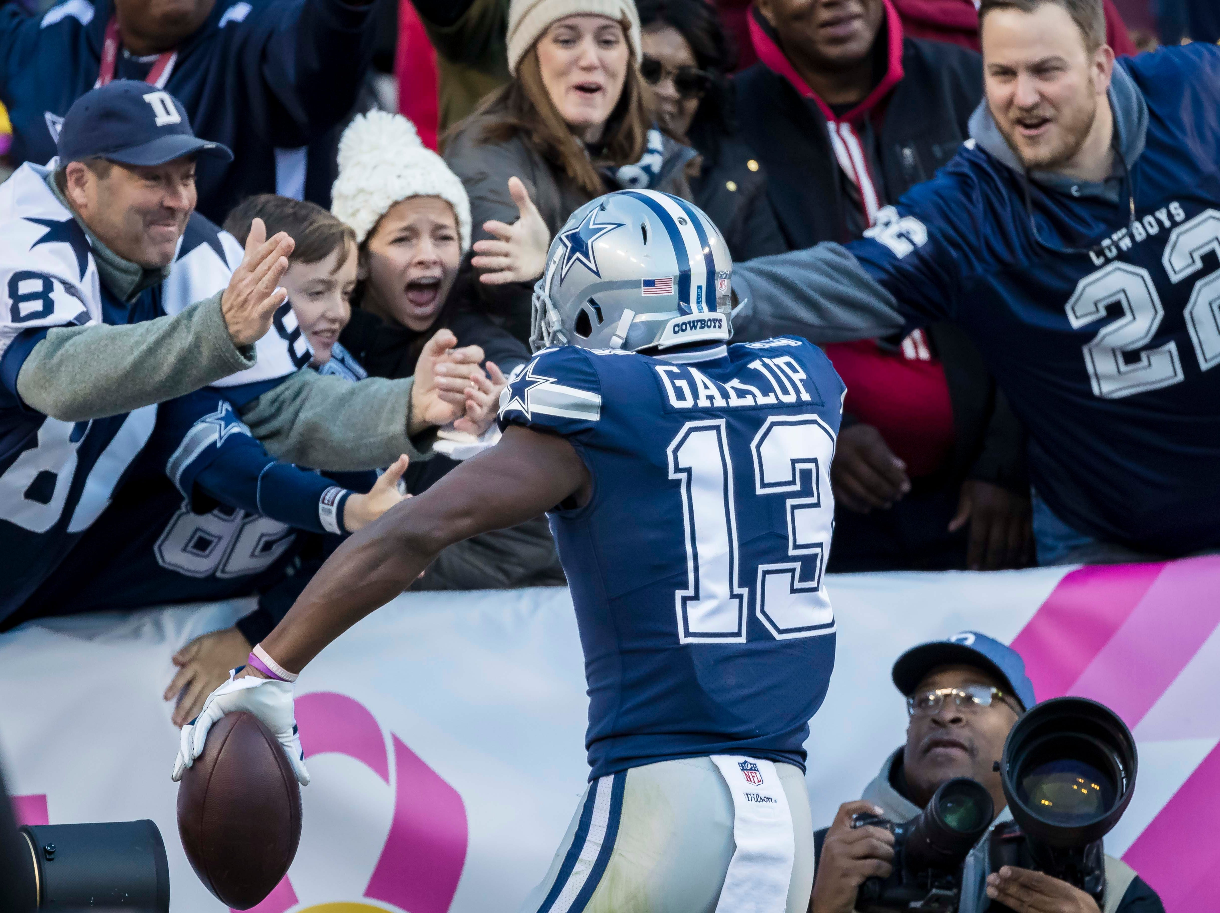 Dallas Cowboys wide receiver Michael Gallup (13) celebrates after scoring a touchdown against the Washington Redskins during the second quarter at FedEx Field.
