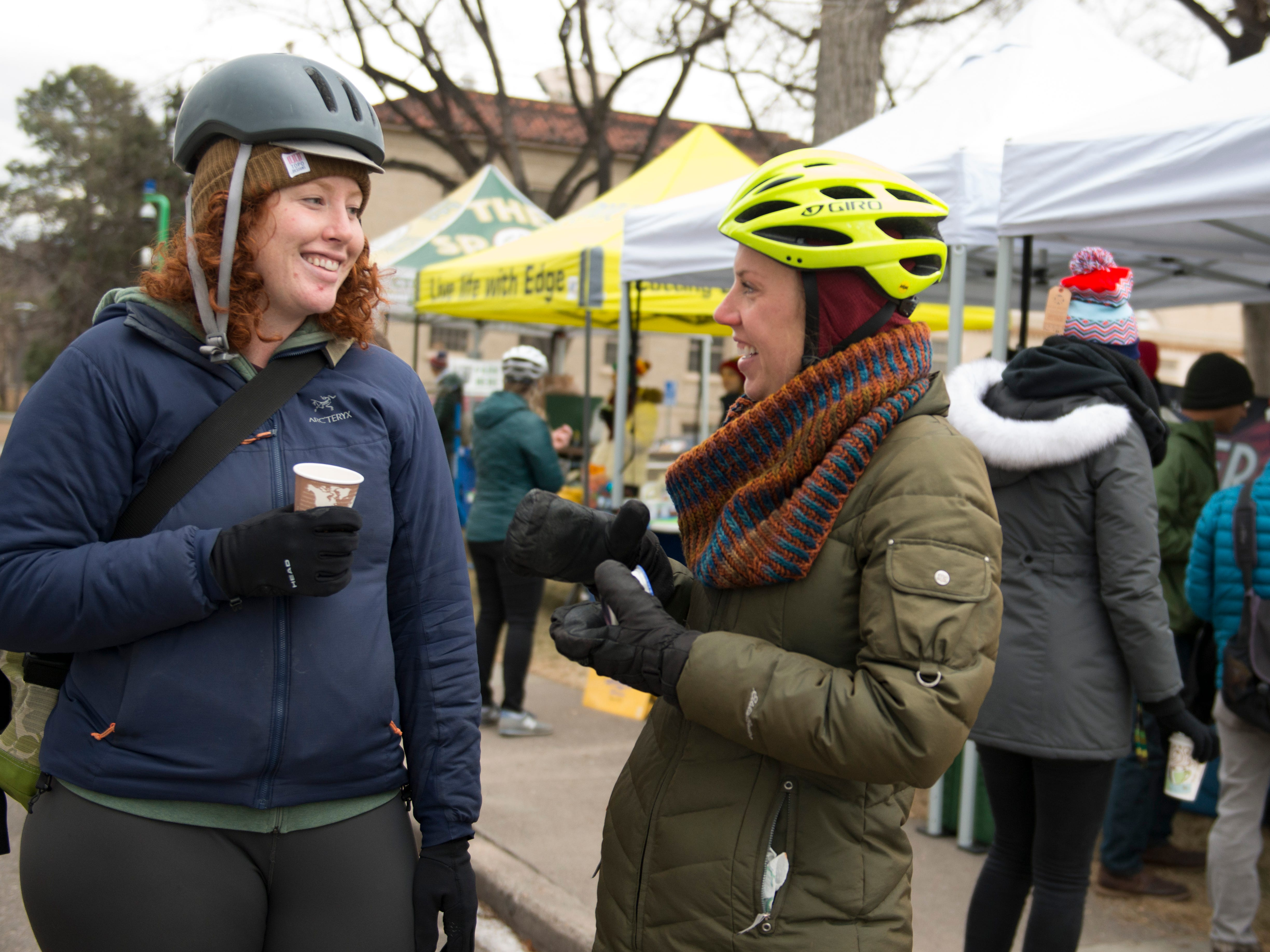 Allie McRae and Molly McLaughlin chat while they sip coffee at a Winter Bike to Work Day station in the CSU Oval on Wednesday, December 12, 2018. Commuters were treated to free breakfast and coffee at nearly 50 stations around Fort Collins.