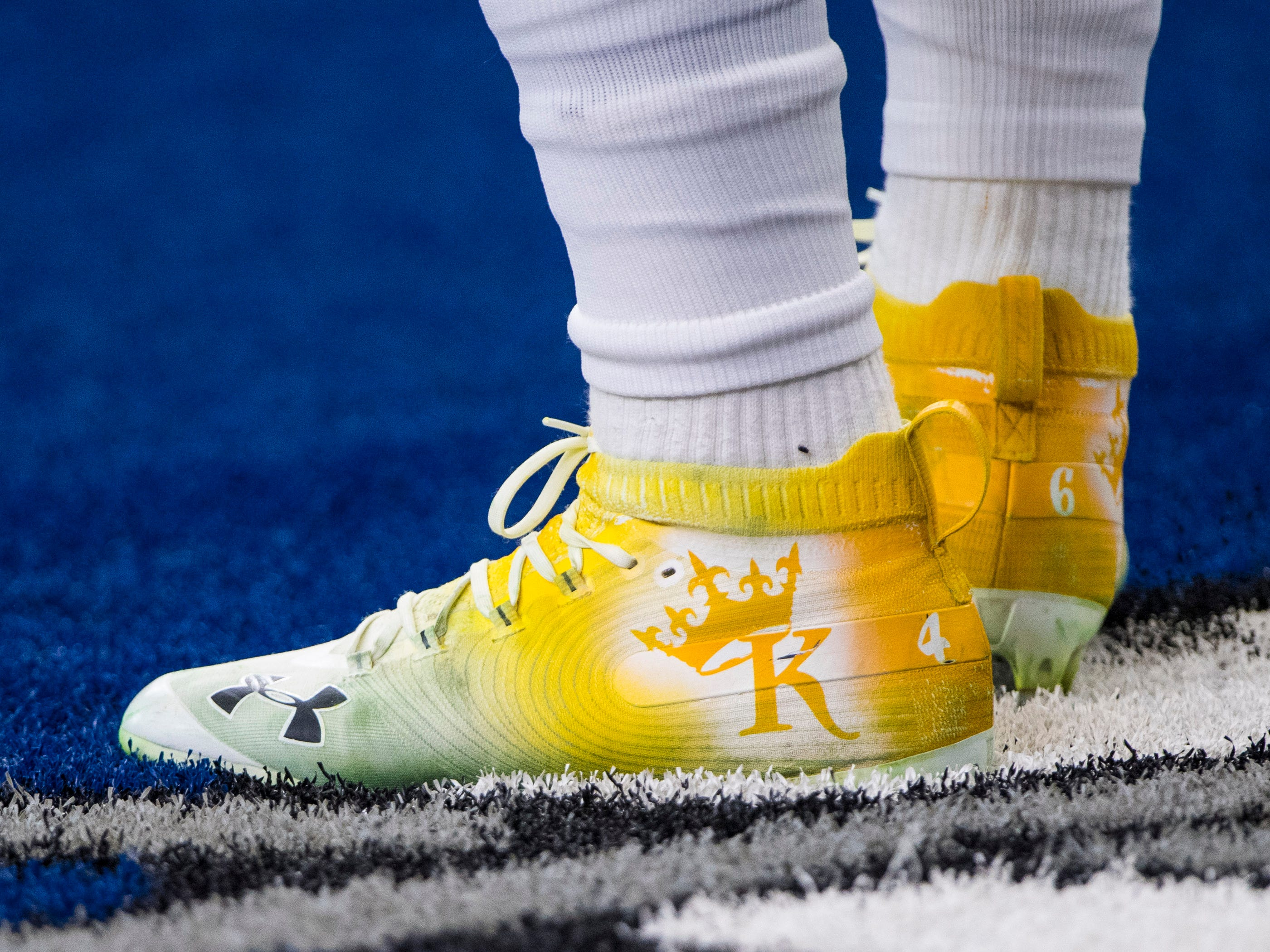 A view of the shoes of Washington Redskins running back Kapri Bibbs (46) as he warms up before the game against the Dallas Cowboys at AT&T Stadium.