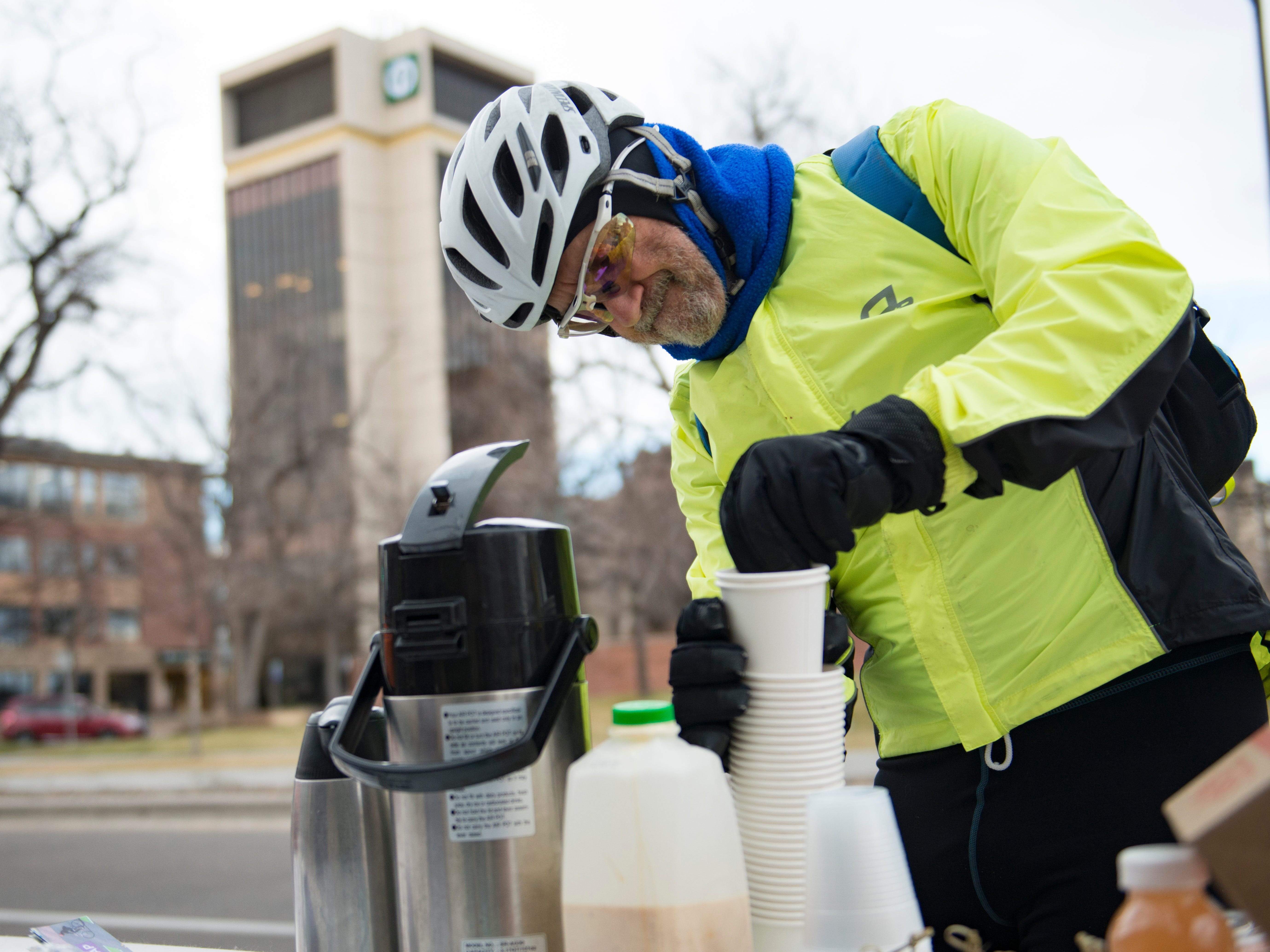 Lee Marchand gets a cup of coffee at Everyday Joe's Coffee House during Winter Bike to Work Day on Wednesday, December 12, 2018. Commuters were treated to free breakfast and coffee at nearly 50 stations around Fort Collins.