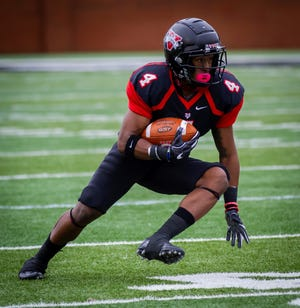 Dunbar's Kenny Benjamin has 37 catches for 389 yards, 102 yards rushing on 14 carries and another 297 on 12 kickoff returns for Valdosta State this season.