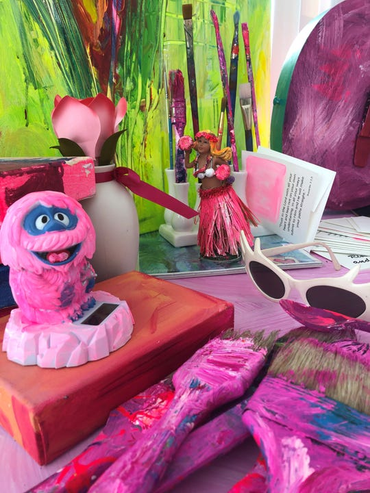 Matlacha artist Leoma Lovegrove has been painting in an all-pink palette since her breast-cancer surgery. That includes her drafting table and these figures.