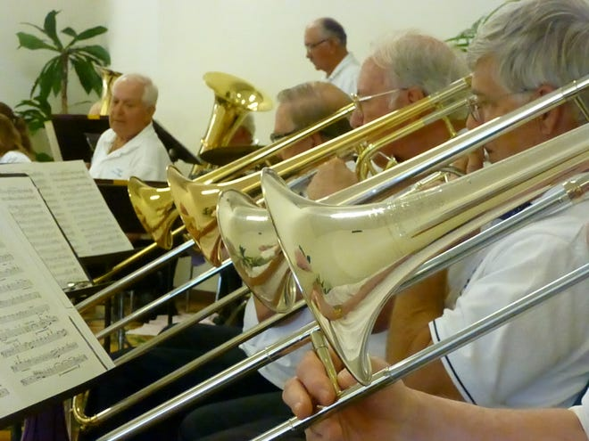 A closeup of Southwest Florida Concert Band's horn section
