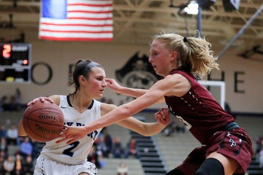 Bay Port's Grace Krause (2) dribbles against De Pere's Jordan Meulemans in a girls basketball game on Dec. 11, 2018, in Suamico.