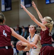 Bay Port's Emma Nagel, center, drives to basket against De Pere in a game on Dec. 11. Nagel and the Pirates are the new No. 1-ranked girls basketball team in the latest G10 power rankings. USA TODAY NETWORK-Wisconsin