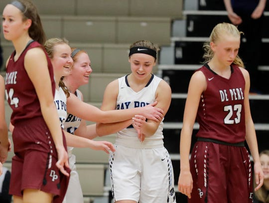 Bay Port's McKenzie Johnson (22) reacts with her teammates after drawing a foul against De Pere in a Dec. 11 game. Bay Port is once again the top-ranked team in the G10 composite power rankings.