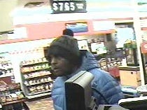 Police seek help identifying 'remorseful' robber in two Tuesday night armed robberies