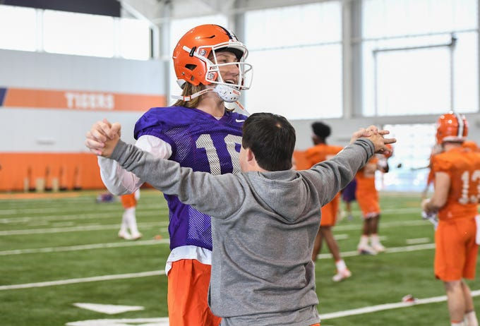 Clemson quarterback Trevor Lawrence (16) with team manager David Saville during the Tigers Cotton Bowl practice on Wednesday, December 12, 2018.