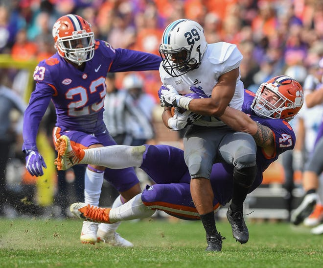 Clemson linebacker James Skalski (47) brings down Citadel running back Grant Drakeford (29) during the 1st quarter on Saturday, November 18, 2017 at Clemson's Memorial Stadium.