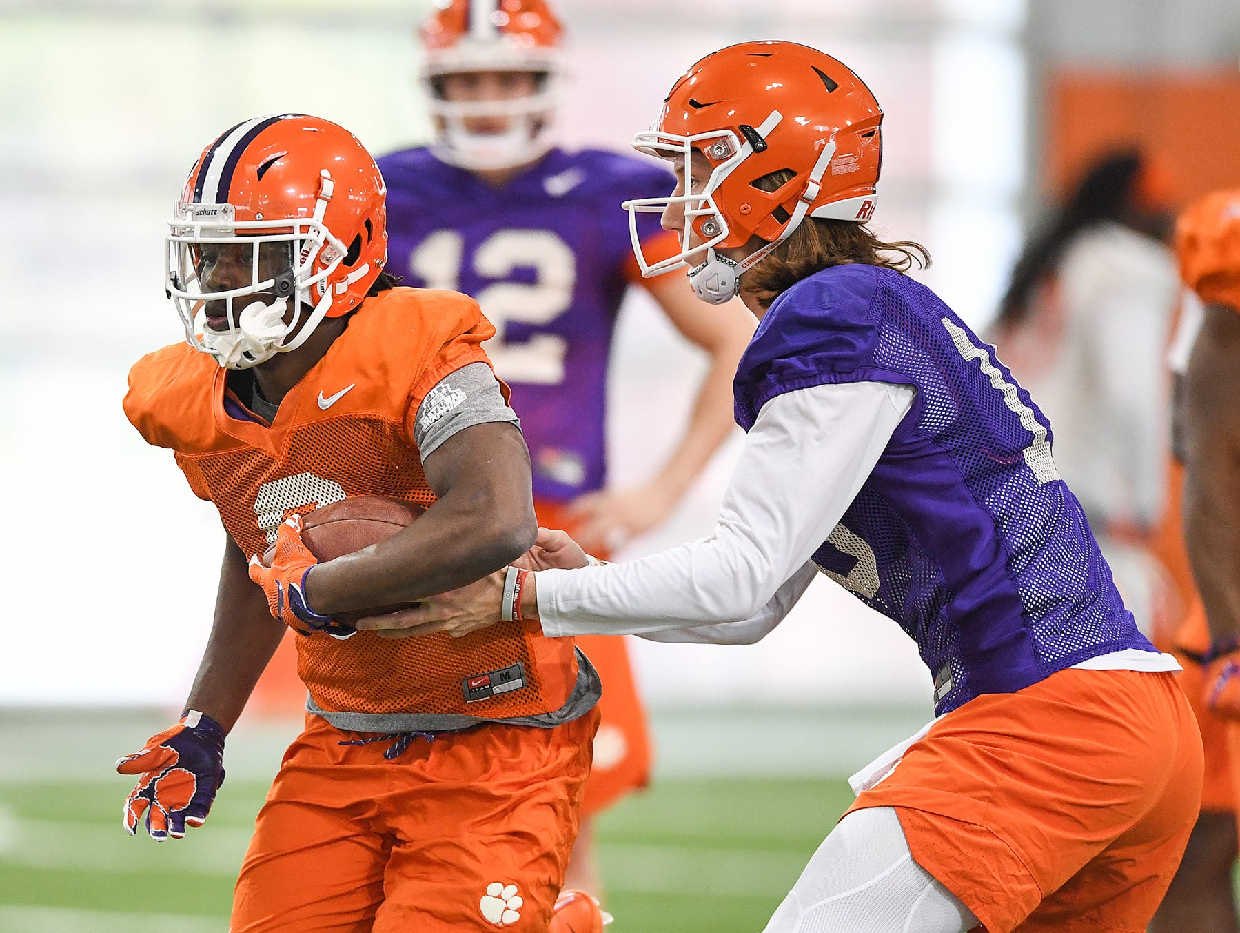 Clemson quarterback Trevor Lawrence (16) hands off to running back Travis Etienne (9) during the Tigers Cotton Bowl practice on Wednesday, December 12, 2018.