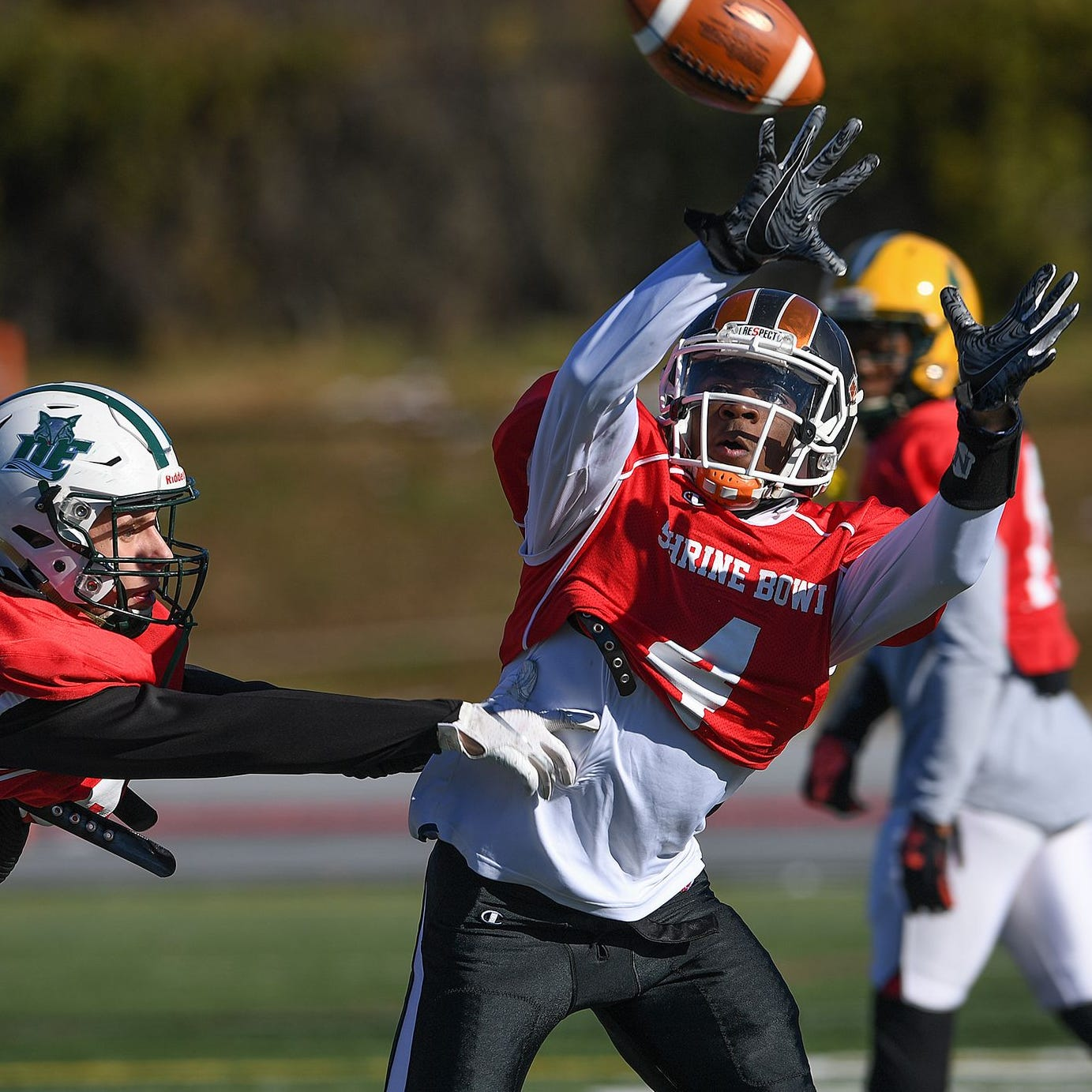 Southside wide receiver Jalon Calhoun (4) tries to pull in a pass in past Dutch Fork defensive back Hugh Ryan (24) during South Carolina's Shrine Bowl practice Tuesday.