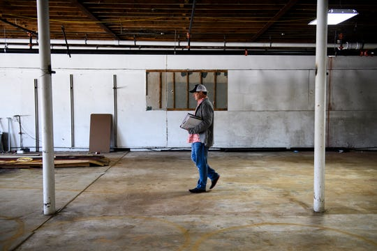 Josh Beeby, owner of Barley's and the Trappe Door, walks through the interior of his new restaurant, The Burrow, set to open next year, on Tuesday, Dec. 11, 2018.